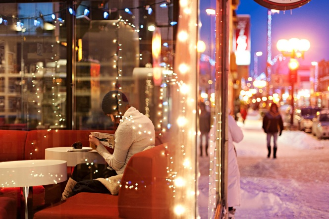 Girl Reading In Coffee Shop Image